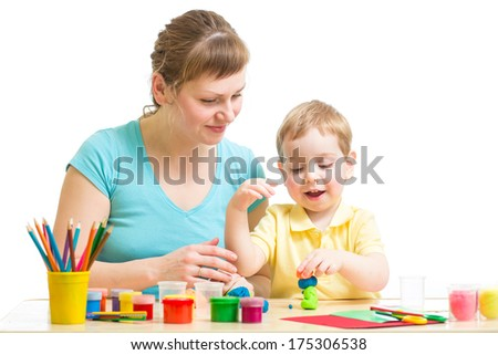 Parent and child plasticine modeling together isolated on white - stock photo