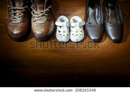 Parent and child shoes - Family - stock photo