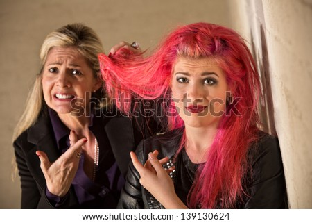 Parent and teen daughter arguing about hairdo - stock photo