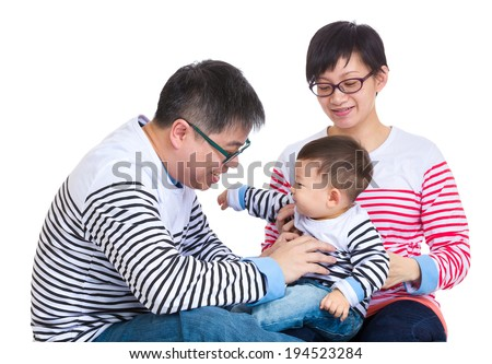 Parent having fun with baby son - stock photo