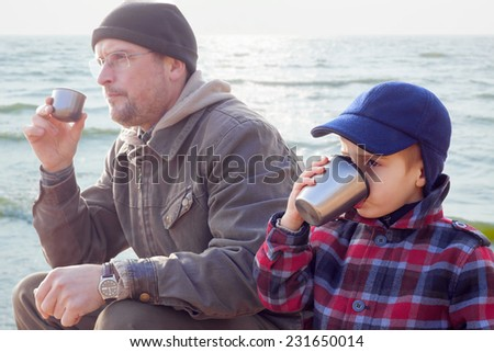 parent kid together drink tea coffee nature outdoor - stock photo
