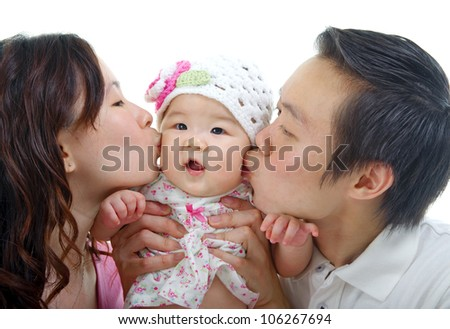 parent kissing their baby girl - stock photo