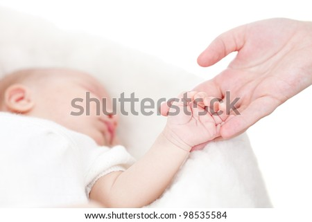 parent's hand holding baby's hand - stock photo
