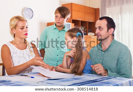 Parent with boy and girl making customer complaints at agency office. Focus on woman
