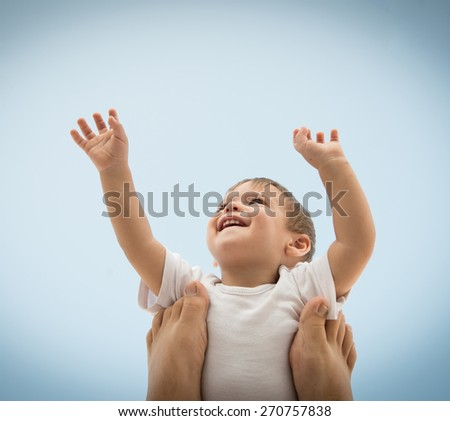 Parenting happy baby holding in air - stock photo