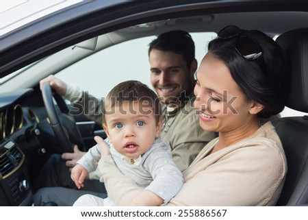 Parents and baby on a drive in their car