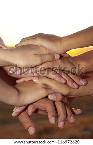 parents and children hold hands in the street - stock photo