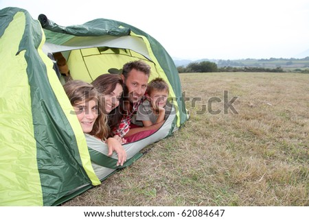 Parents and children in camp tent