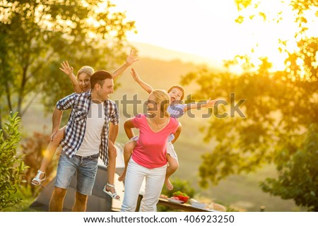 parents and children on vacation playing together outdoor