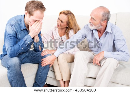 Parents comfort elderly child - stock photo