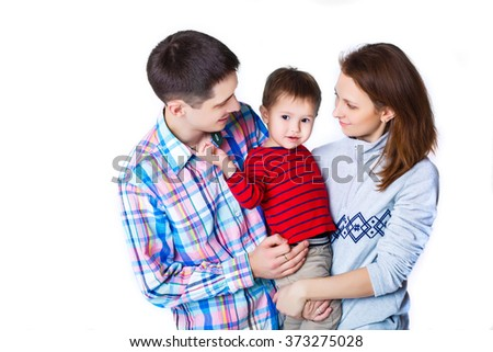 parents embrace son. mommy, daddy and little baby boy. happy family - stock photo