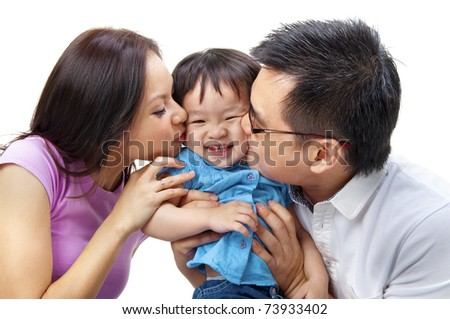 Parents giving their daughter a kiss attack. - stock photo