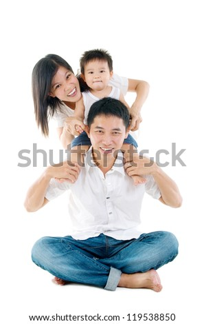Parents having piggyback fun with their lovely son - stock photo