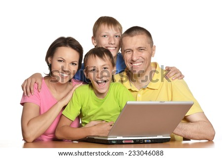 Parents help children do their homework at table - stock photo