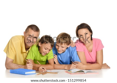 Parents helping boys with homework - stock photo