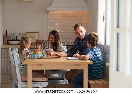 helping parents help their children homework parent helping kid doing homework