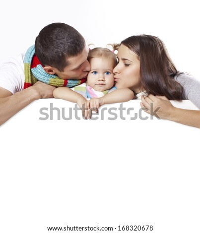 Parents kiss the child on the banner - stock photo