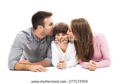 Parents kissing their son  - stock photo