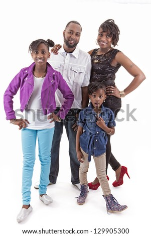 parents posing with their two daughters on white background - stock photo