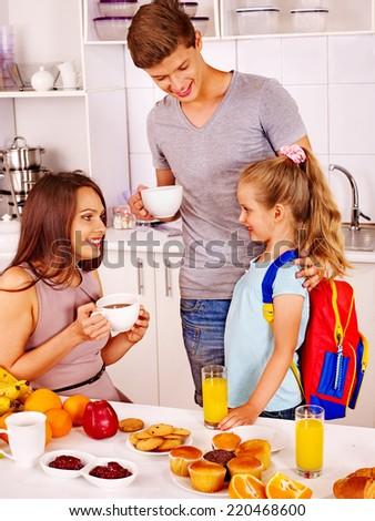 Parents prepare  child for school. Happy family. - stock photo
