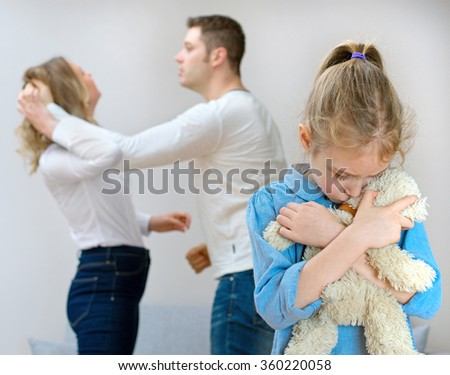 Parents quarreling at home, child is suffering. - stock photo