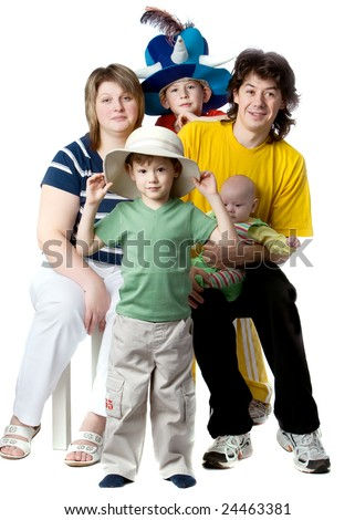 Parents together with children, on elder sons carnival hats, isolated on white