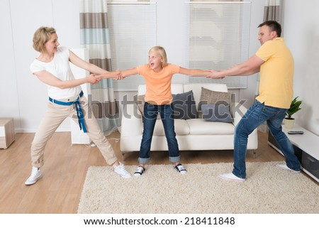 Parents Under Divorce Dividing Kids At Home - stock photo
