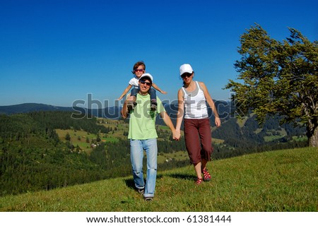 Parents with a child having a walk outdoors