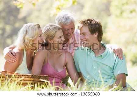 Parents with adult children on picnic - stock photo