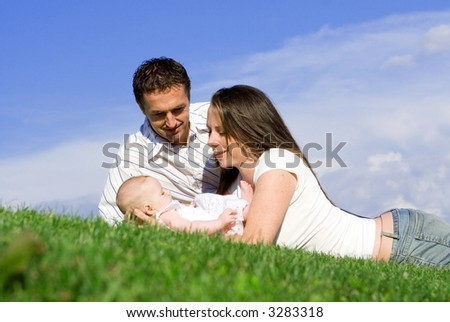 parents with baby - stock photo