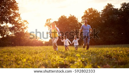Parents with children on recreation in nature