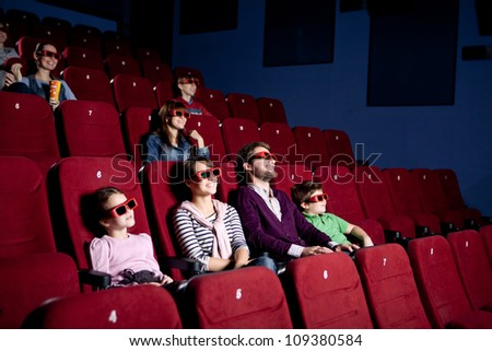 Parents with children watching a comedy in 3D movie - stock photo