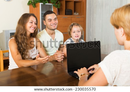 Parents with daughter glad hearing words of social worker - stock photo
