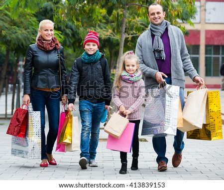 Parents with school age children enjoying shopping in city