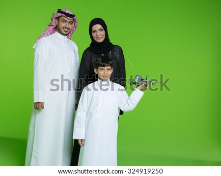 Parents with son holding toy airplane - stock photo