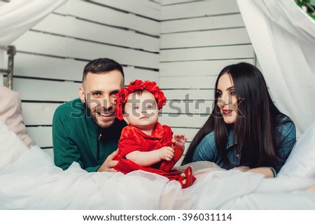 parents with their baby - stock photo