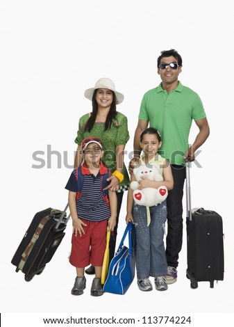 Parents with their children going for vacations - stock photo