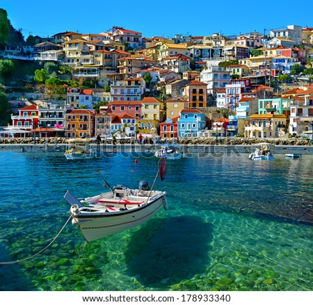Parga boat - heaven on earth -  Greece holidays - clear sea and reflaction - stock photo