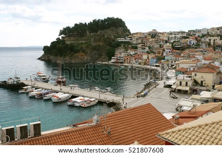 Parga, GREECE, May 09, 2013: View on the Greek coast with boats in bay of Parga town on the coast of Ionian Sea.