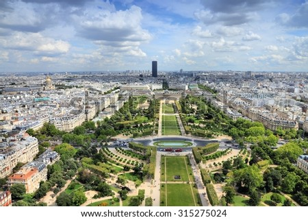 Paris aerial view from Eiffel Tower - French capital city architecture with Champ de Mars gardens. - stock photo