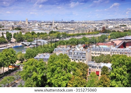 Paris aerial view from Eiffel Tower - French capital city architecture with river Seine. - stock photo