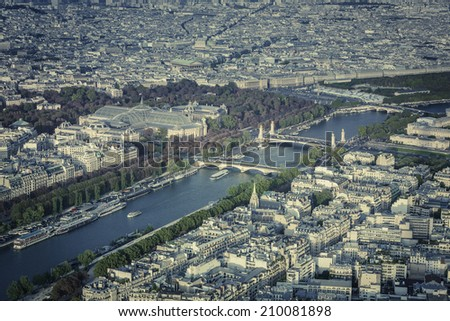 Paris aerial view with cruise ships on Seine River, France - stock photo
