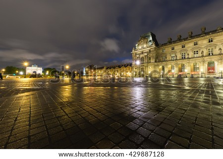 PARIS - APR 15 : Louvre museum at twilight in summer on April 15,2016. Louvre museum in rainy day.