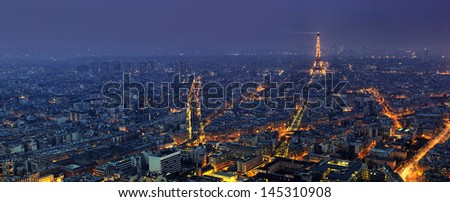 PARIS - APRIL 5: Aerial panoramic view of Paris at night from Tour Montparnasse on April 5, 2013 in Paris, France. The Eiffel tower is the most visited touristic attraction in France.