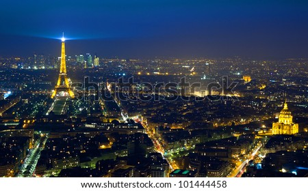 PARIS - APRIL 23: Cityscape of Paris with Eiffel Tower at night on April 23, 2012. The Eiffel tower is the most visited monument of France with about 6 million visitors every year. - stock photo
