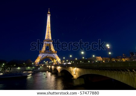 PARIS - APRIL 19 : Eiffel tower at night on April 19, 2010 in Paris. The Eiffel tower is the most visited monument of France. - stock photo