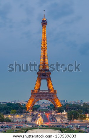 PARIS - APRIL 24, 2011: Eiffel Tower brightly illuminated at dusk on April 24, 2011 in Paris. The Eiffel tower is the most visited monument of France.