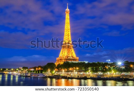 PARIS - 26 APRIL,2017: Eiffel Tower in the Dusk on April 26, 2017. The Eiffel tower is the most visited monument of France located oh the bank of Seine river in Paris, France.