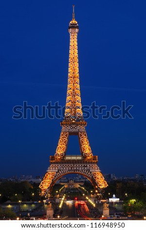 PARIS - APRIL 9: Eiffel Tower Light Beam Show at dusk on April 9, 2011 in Paris, France. Eiffel Tower is the highest monument in France and uses 20,000 light bulbs in the show. - stock photo