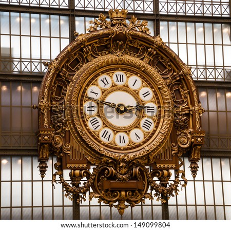PARIS - APRIL 7: Golden clock of the museum D'Orsay as seen on April 7, 2013 in Paris, France. Musee d'Orsay has the largest collection of impressionist and post-impressionist paintings in the world. - stock photo